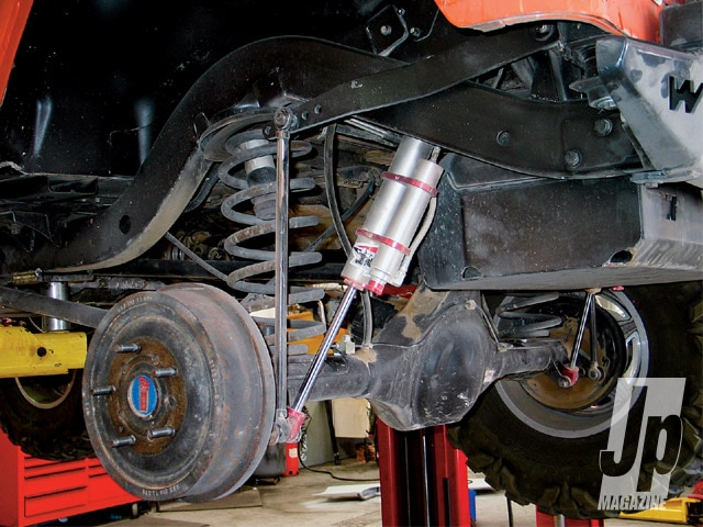 Here's Miller's pre-conversion setup. With 3-inch Teraflex coils, 8-inch Walker Evans shocks, and a Currie AntiRock it's actually a great suspension. Although the rear hit the bumpstops on compression now and again, the 9 inches of travel wasn't too shabby. However, in the interests of more potential suspension travel, a cleaner design, and our nagging, Miller removed, cut, and ground the factory spring and shock mounts off the frame and axle tubes for our cameras.