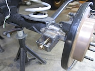 The outboard shock towers are universal and need to be trimmed to