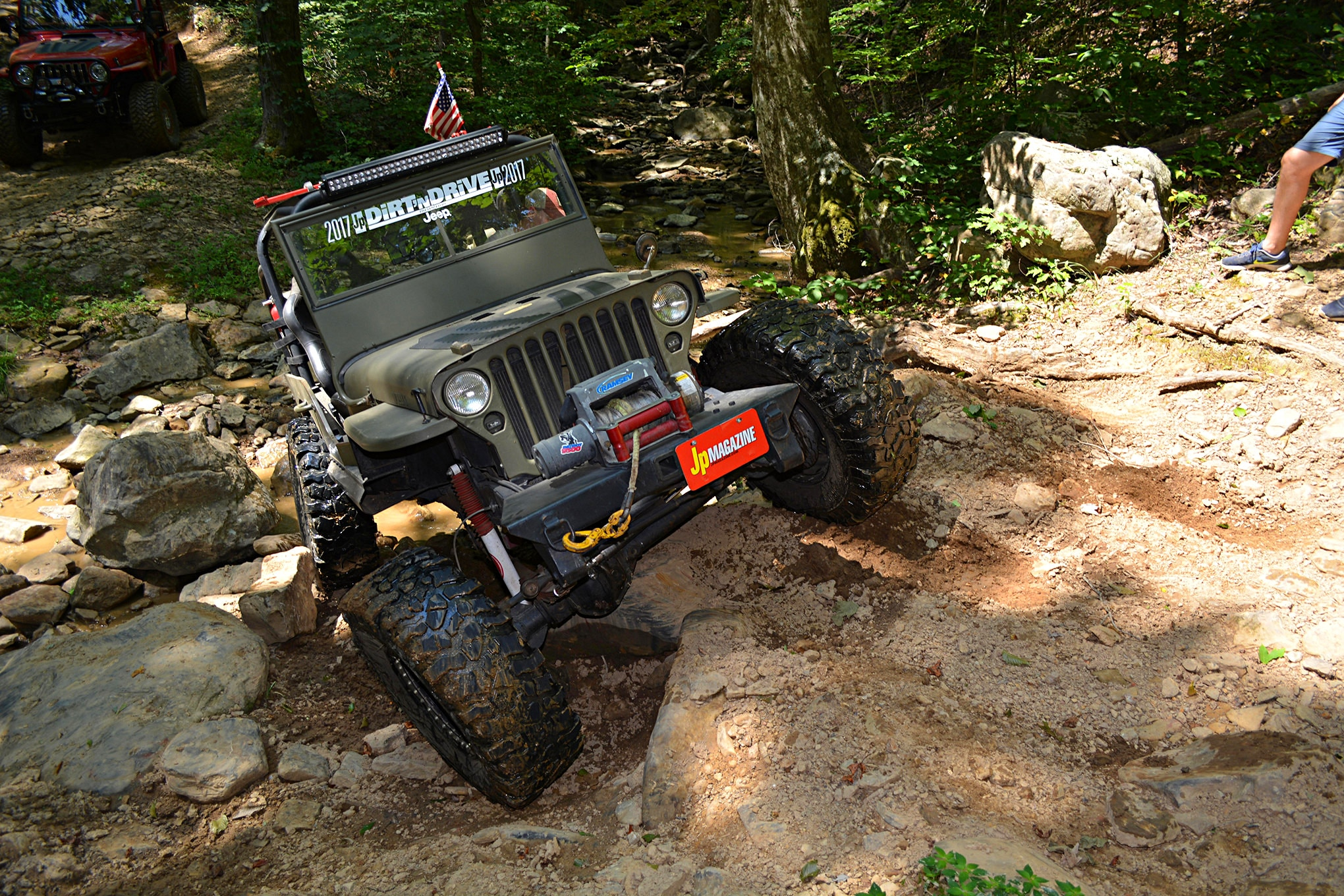 This creek crossing is deceiving when you are on the approach. The rocks are a bit slick upon entry and can throw you off the line quickly, making the departure to the hard-right turn almost impossible. Carson Qualls in his Willys CJ-2A navigated it rather smartly.