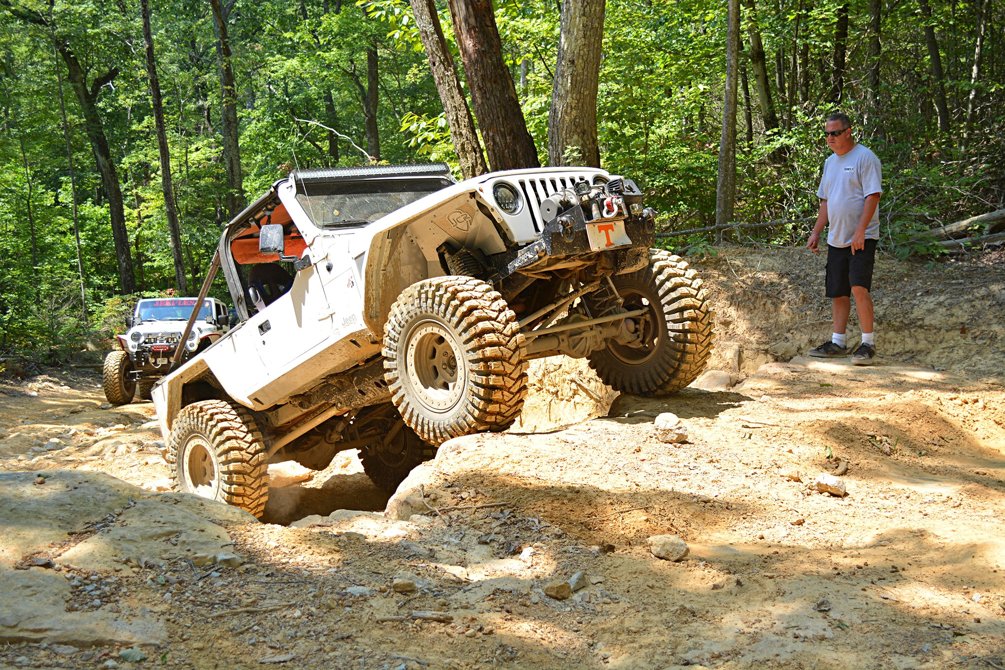 While not needed on all trails, lockers are beneficial for those taking the more difficult lines. Mark Hendrix handled this ledge easily in his 2006 LJ Rubicon.