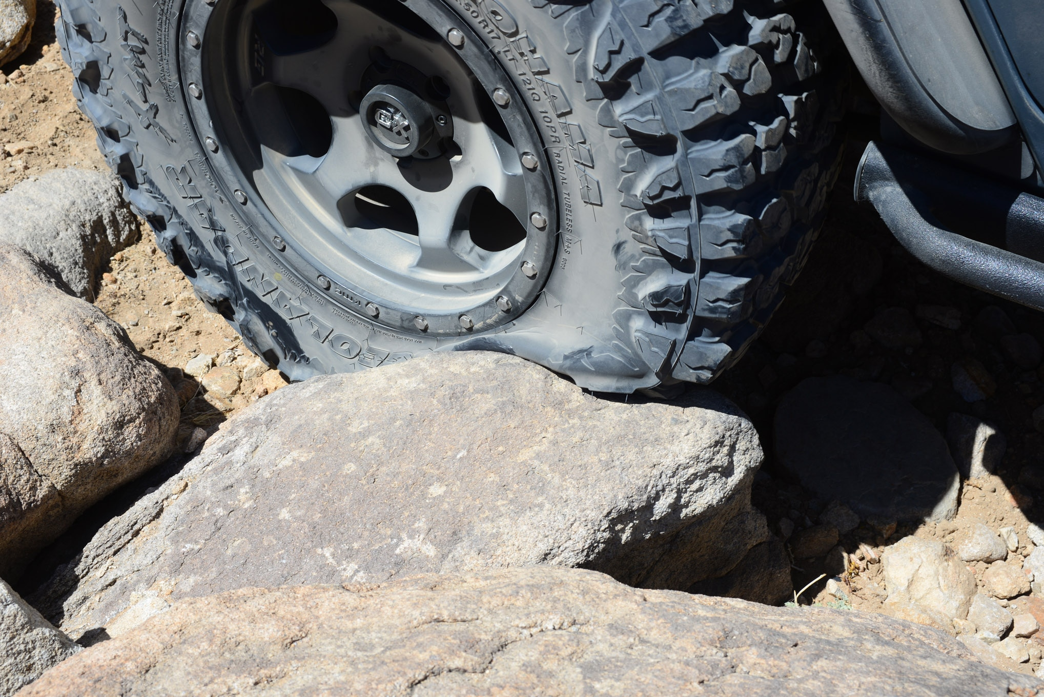 Three-ply sidewalls assure a tough tire. Note the flexibility though as an aired-down version folds its tread around the rock without any sidewall damage. The Geo-Shield construction is said to be more durable than any previous offering.
