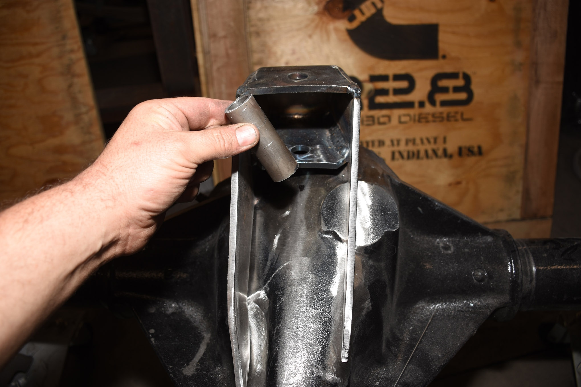 This sleeve cut on a lathe is about 0.030 inch longer than the mounting surface of the 1 1/4-inch uniball. That extra length helps when the steel shrinks during welding, allowing the uniball to fit in the pocket more easily when the bolt is out. The sleeve stays in place during all the welding on the truss and housing.