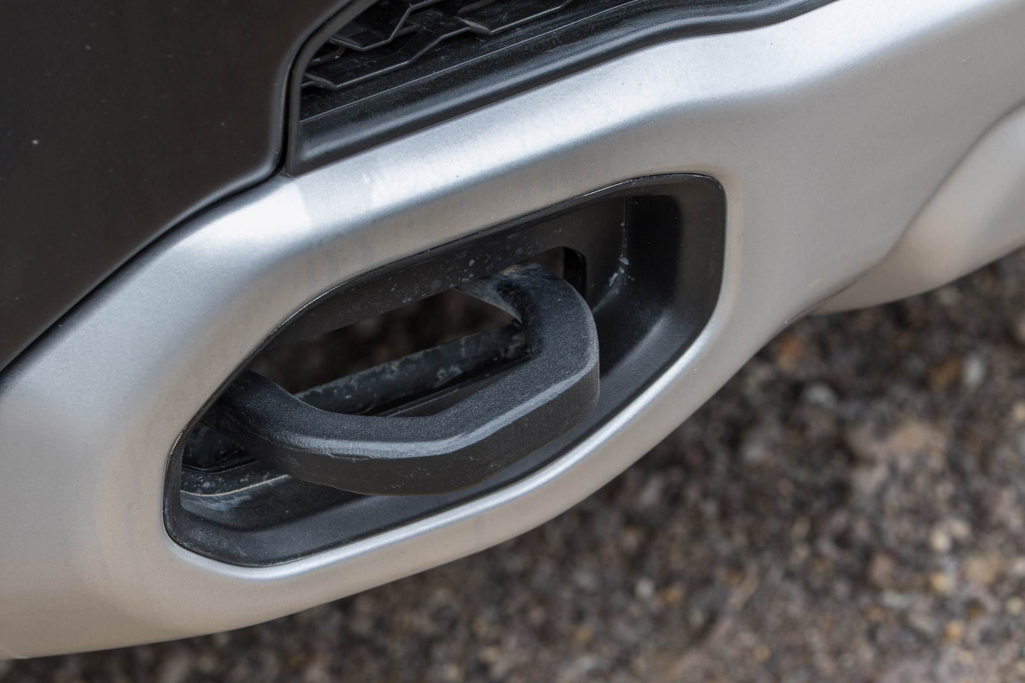The Ram Rebel has enclosed towhooks in the front bumper that are tied into the framerails. They protrude far enough to get a soft shackle through them while having a minimal impact on approach angle.