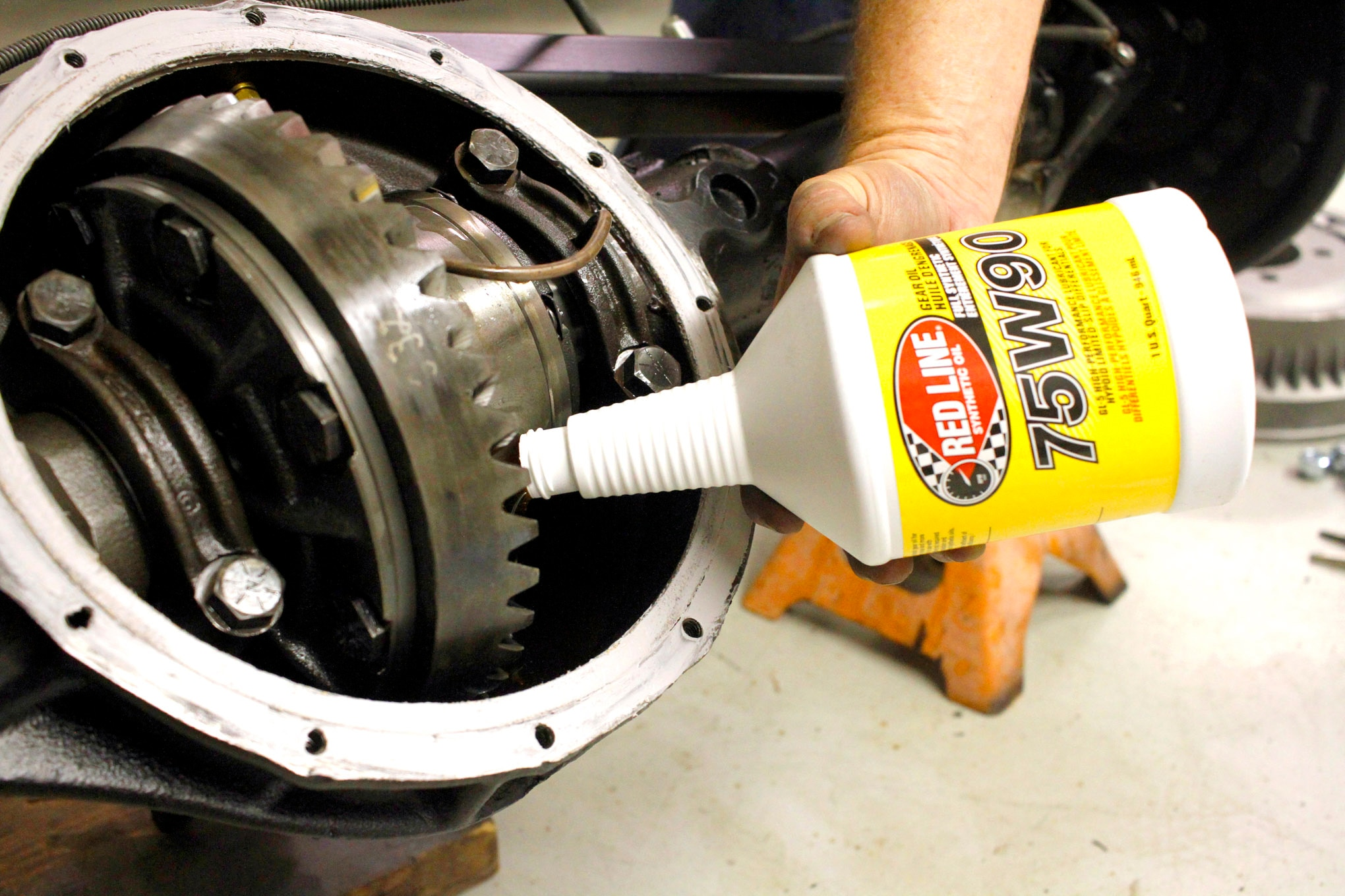 Since we had the rear cover off the axle, it was easy to fill the differential without having to pump fluid into the fill hole. We added about two quarts of Red Line 75W90 GL-5 synthetic gear oil as a start and checked the final fluid level after the axle was mounted back on the Jeep.