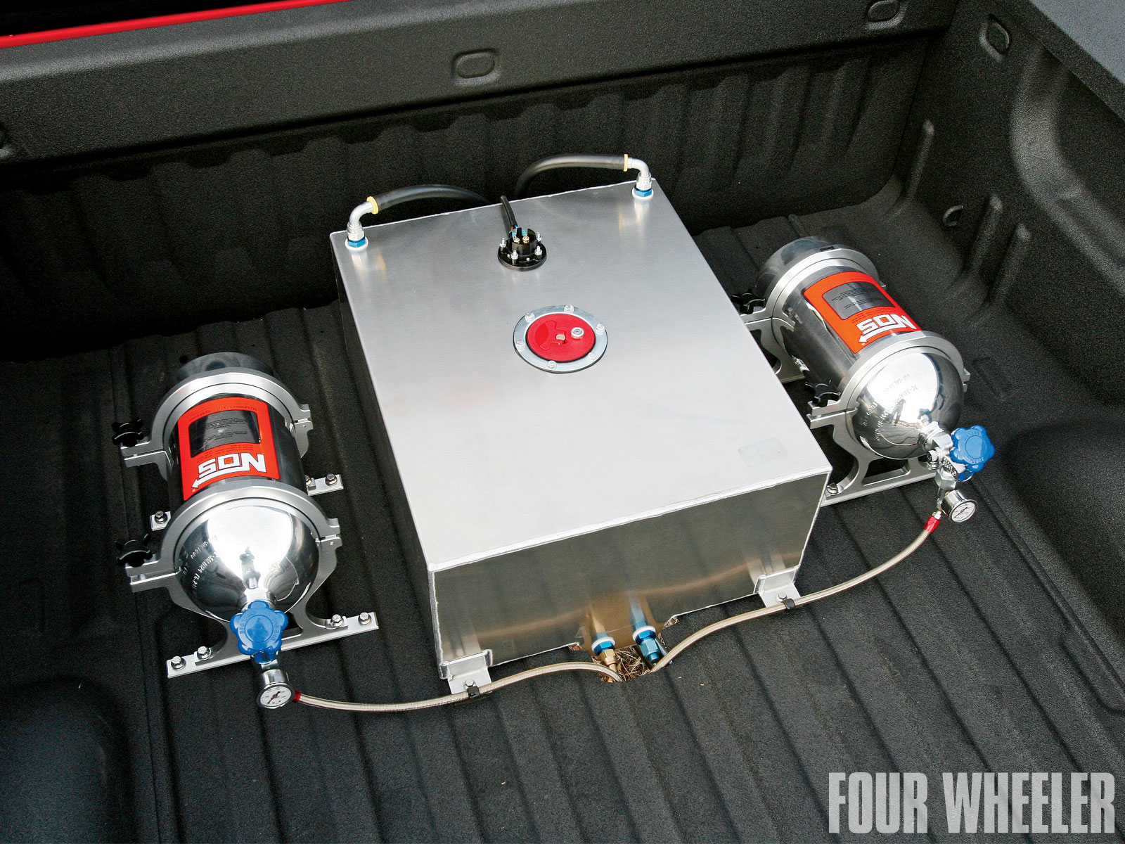 The modified Duramax turbodiesel is fed biodiesel via a bed-mounted JAZ Products 20-gallon fuel cell. Also in the Xtreme Liners-lined cargo area is a pair of Nitrous Oxide Systems (NOS) 10-pound tanks. When we photographed the truck, the nitrous system was not yet operational, but Bigfoot says that when it is, the truck will undergo dyno tuning to coordinate the fuel system and programming mods so that it can all work in harmony. NOS says the system generates 75 horsepower in stock applications.