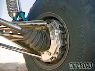The rear suspension uses tubular trailing arms, 300M axles