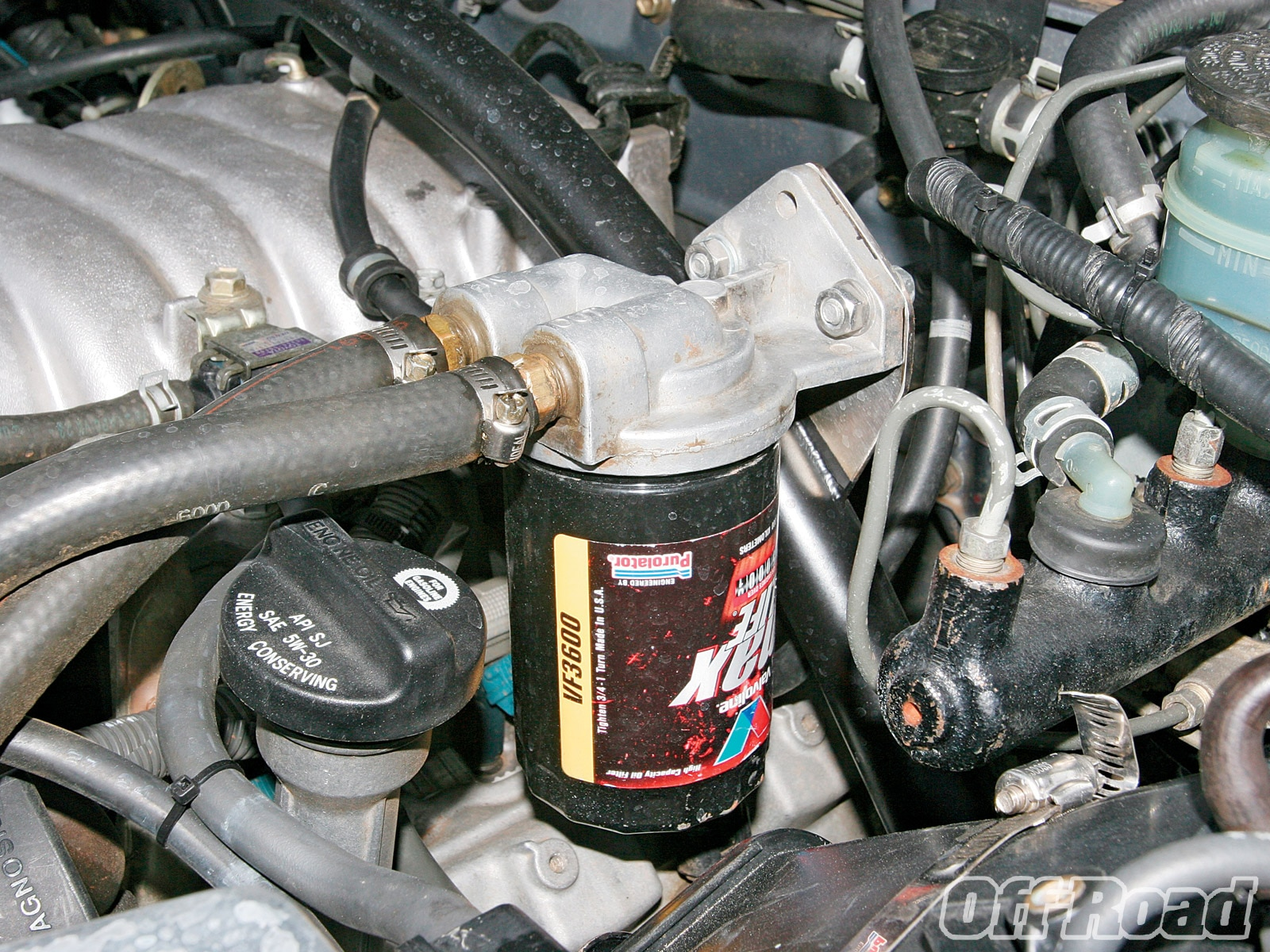 Engine swapping is an exercise in logistics. The oil filter wouldn't fit in the stock position, so Will used a remote mounting kit and placed the filter on the shock hoop crossbar.
