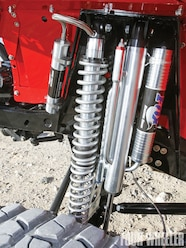 Locating the front axle is a custom three-link setup made