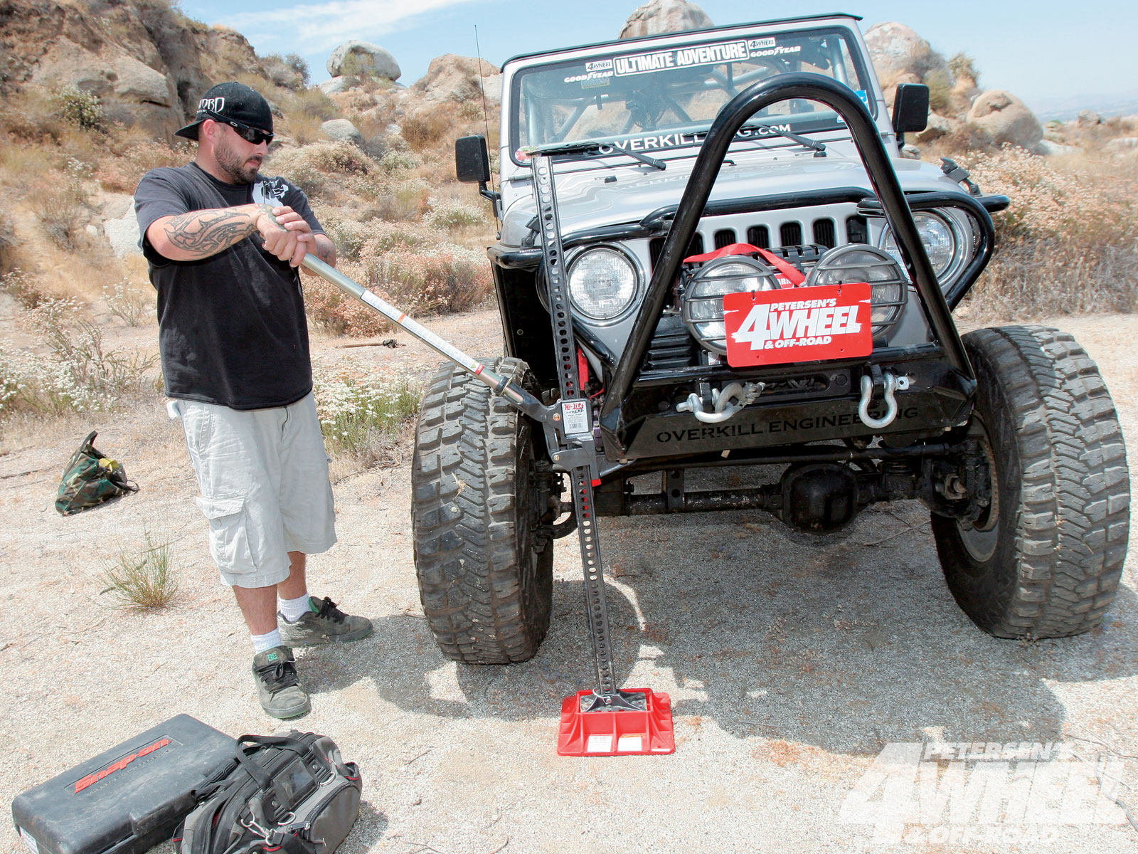 Before tearing into the axle, place the vehicle on level ground and off the trail. When using a Hi-Lift jack in sand and dirt, we always recommend using the off-road base since it provides more stability. A floor jack or scissors jack are another option if available.