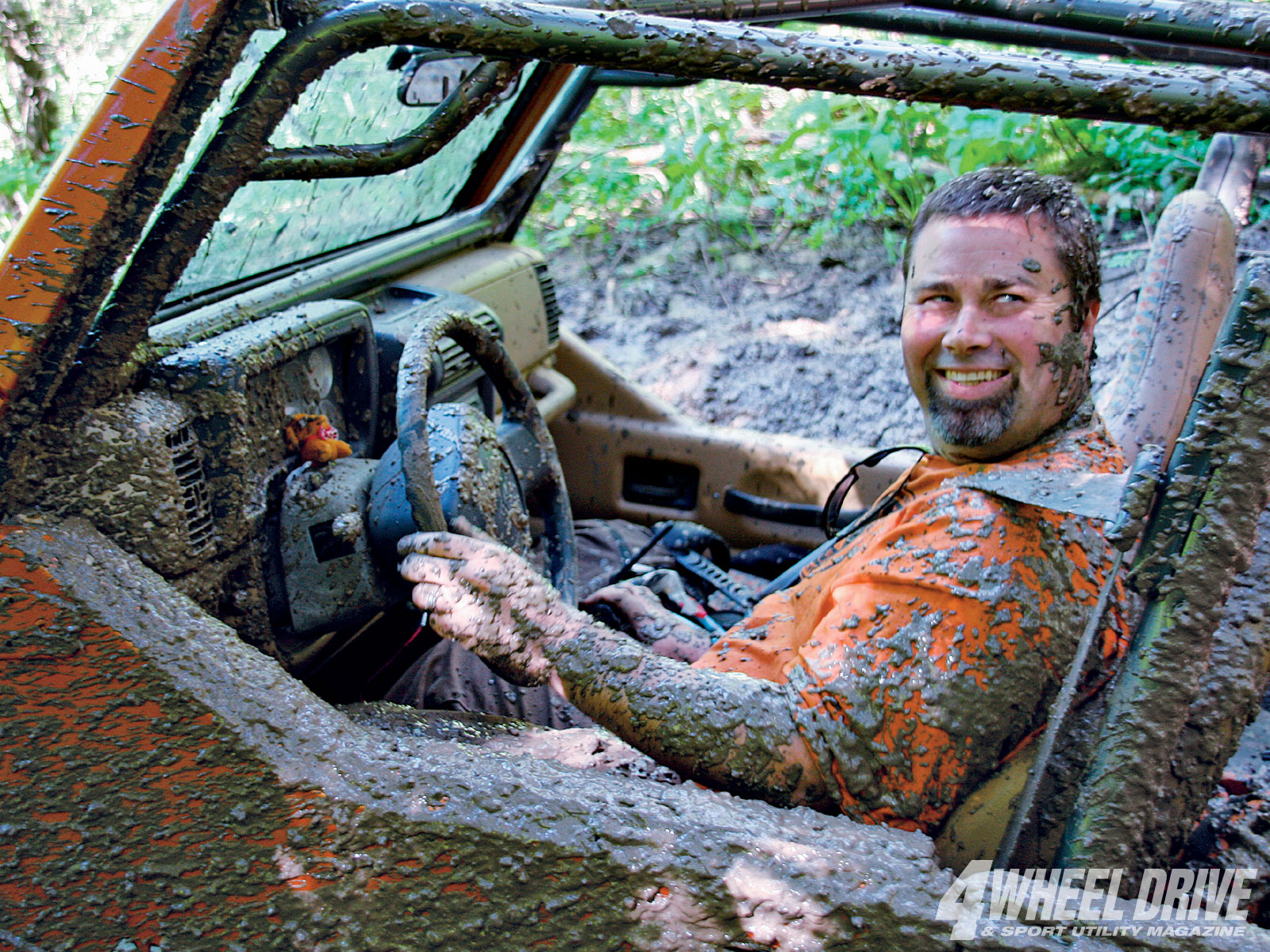 This shot pretty much sums up day one of Trail Tour 2010. Carl Yarbrough of Old Town Customs is all smiles after giving the mud his all in his custom TJ. The result? Mud: 1, Carl: 0. He buried the Jeep (and himself) and had to resort to the winch cable.