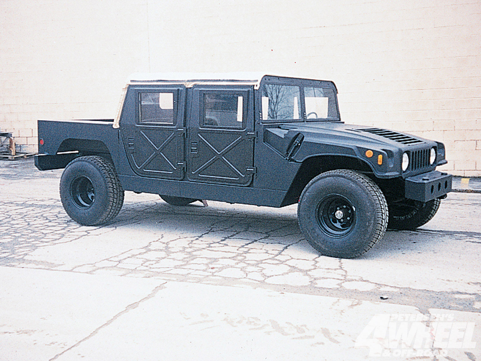 Shown here with a soft top and hard doors, the four-door Urban Gorilla mounts on a Suburban or domestic fullsize truck chassis. The basic kit is $4,995 for the two-door model and $5,495 for the four-door, but additional costs should be figured in because more than just the basic kit is needed to complete the buildup.