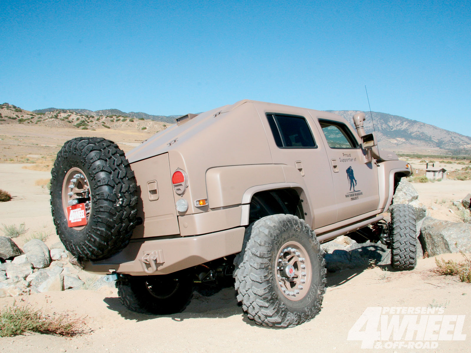 The slant-back top of the H3 is a handcrafted addition made of sheetmetal that's been seamlessly molded to the body. American Hot Rod even took cues from the military HMMWV taillights to try and capture the utilitarian nature of the original H1.