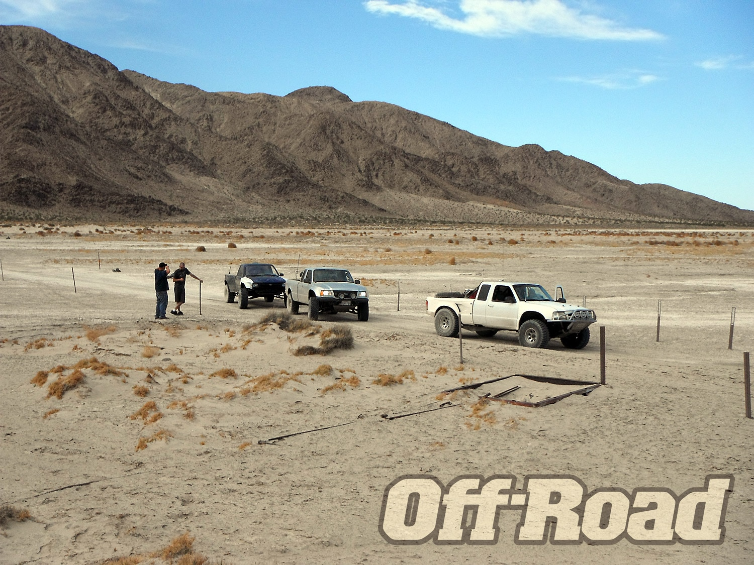 The three trucks at Soda Dry Lake after losing Corey in the wash. He had a tool box explode in his truck bed causing him to fall back and join the Jeep group.