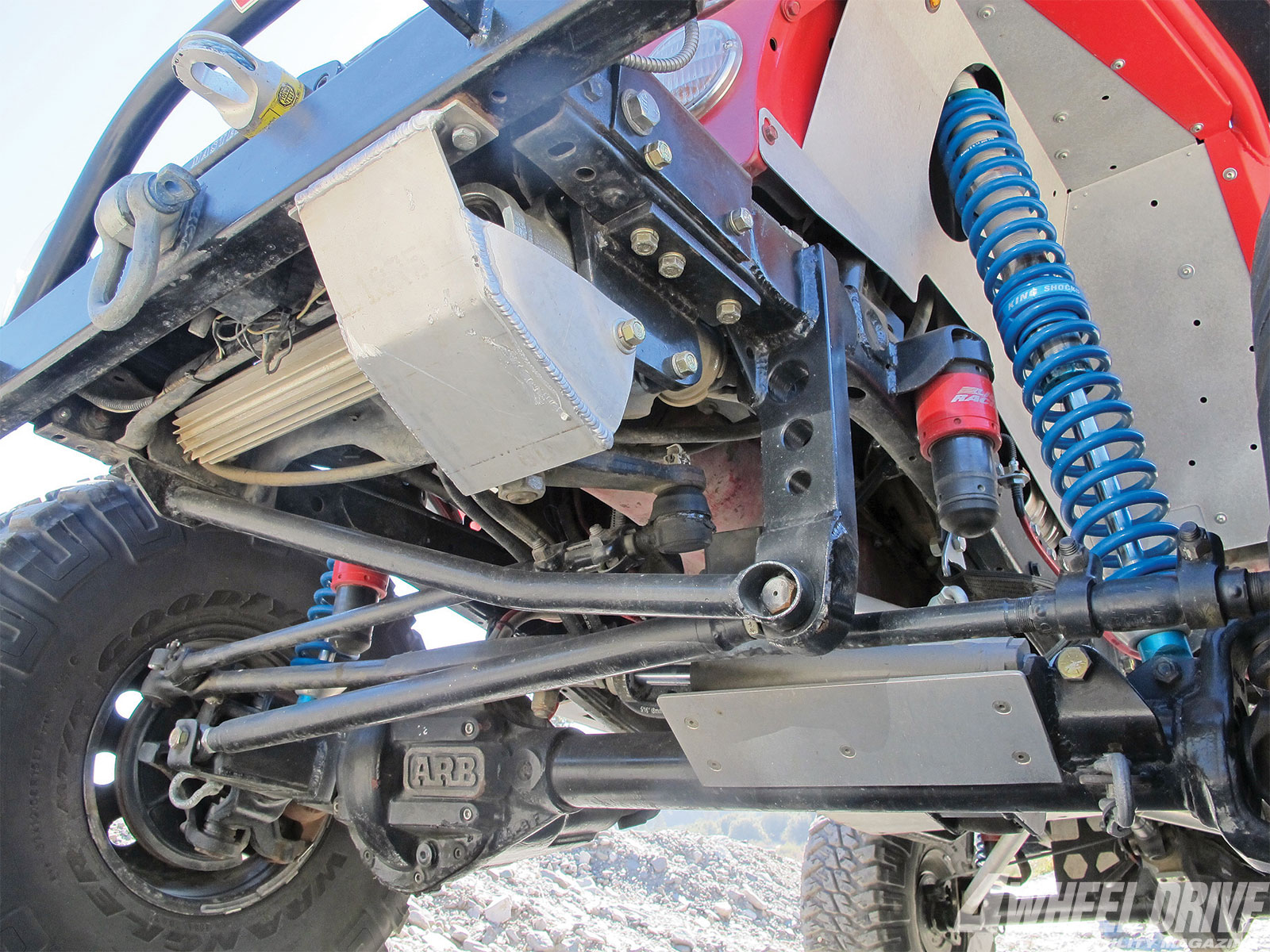 The Tri-County Gear relocated track bar and brace was developed for TJ Wranglers but can be adapted to most custom link/coilover applications. It's a strong and well-designed setup. Tri-County Gear also installed the Light Racing JounceShocks, which serve as active bumpstops.