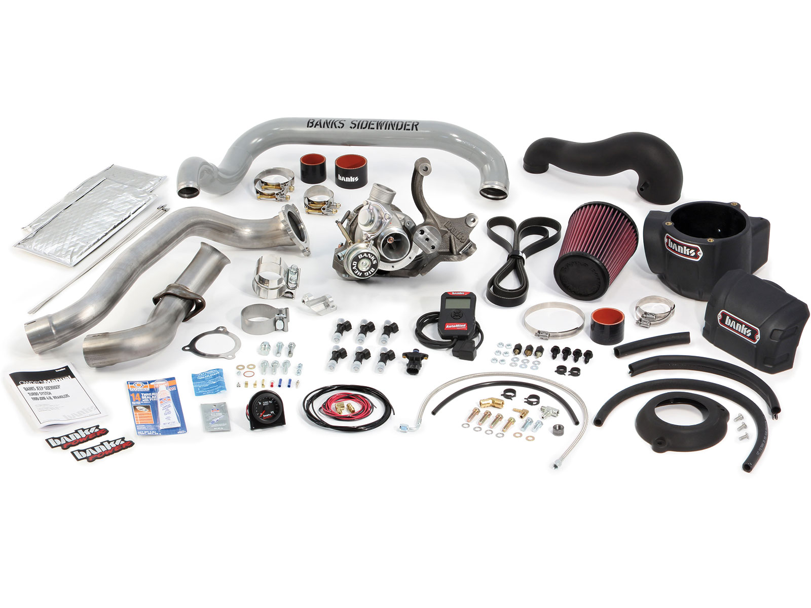 The Banks Power 4.0L Sidewinder Turbo kit includes a turbocharger with integrated wastegate/blow-off valve, a cast-iron turbo mount with alternator relocation, Bosch 35 lb/hr fuel injectors, stainless-steel turbine inlet/outlet pipes, a boost tube with provisions for water injection nozzles, a two-bar MAP sensor with a billet throttle body spacer mount, a handheld flash programmer, a Turbo-specific Ram-Air system with a through-hood Super Scoop, a boost gauge, and all necessary hoses, fittings, and hardware. Installation is relatively simple, and the entire project can be completed in one day.