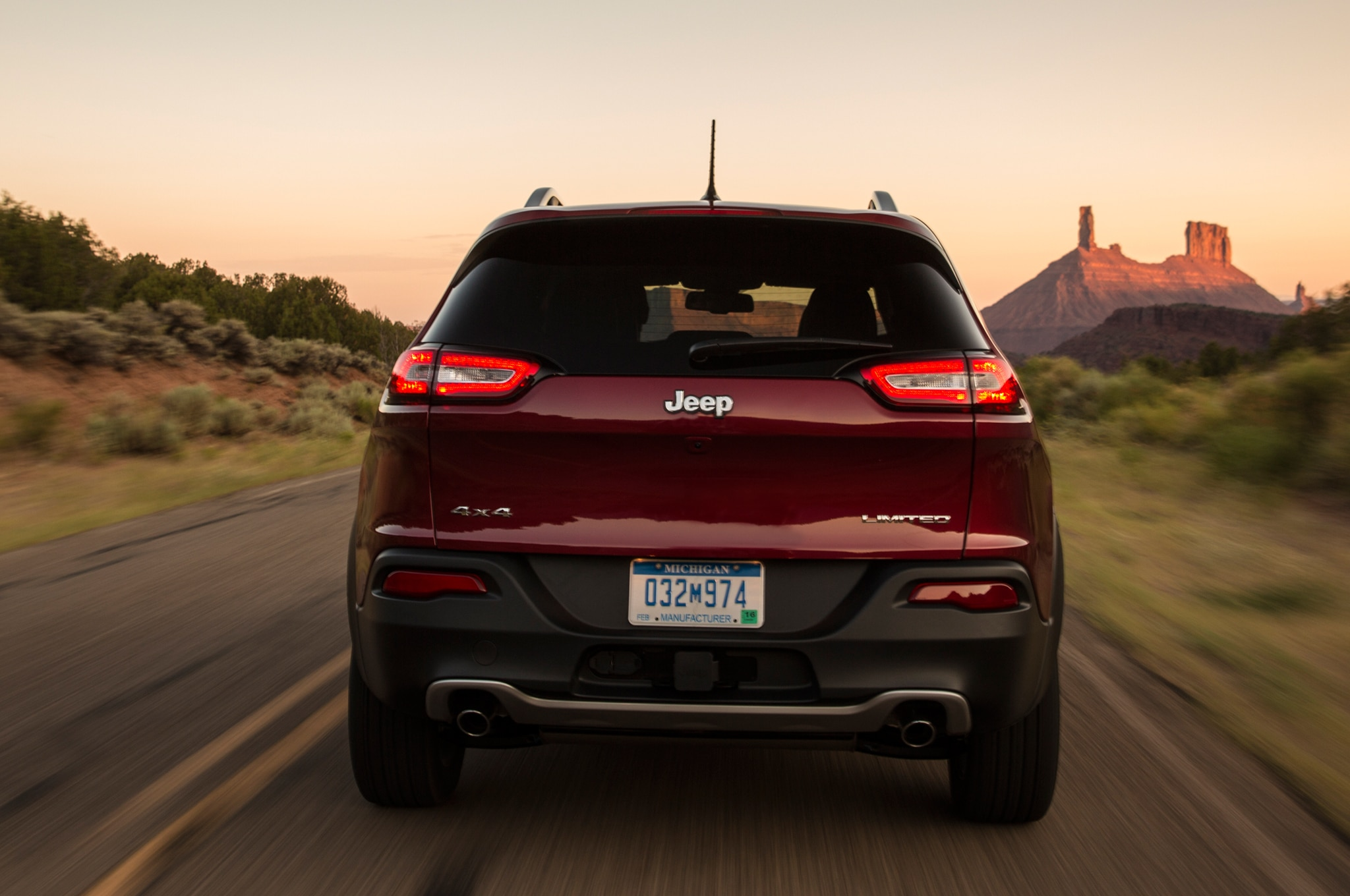 2014 Jeep Cherokee Limited rear profile in motion