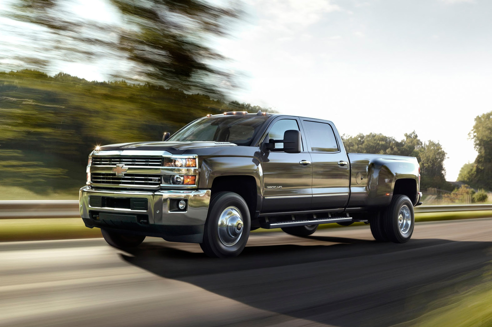 2015 Chevrolet Silverado 3500HD LTZ front three quarters in motion