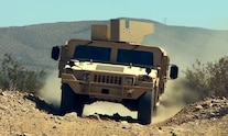 23 Banks AM General M1116 driving down desert two track