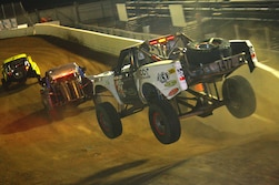 Off Road Race Trucks Let Loose on Sand Sports Super Show