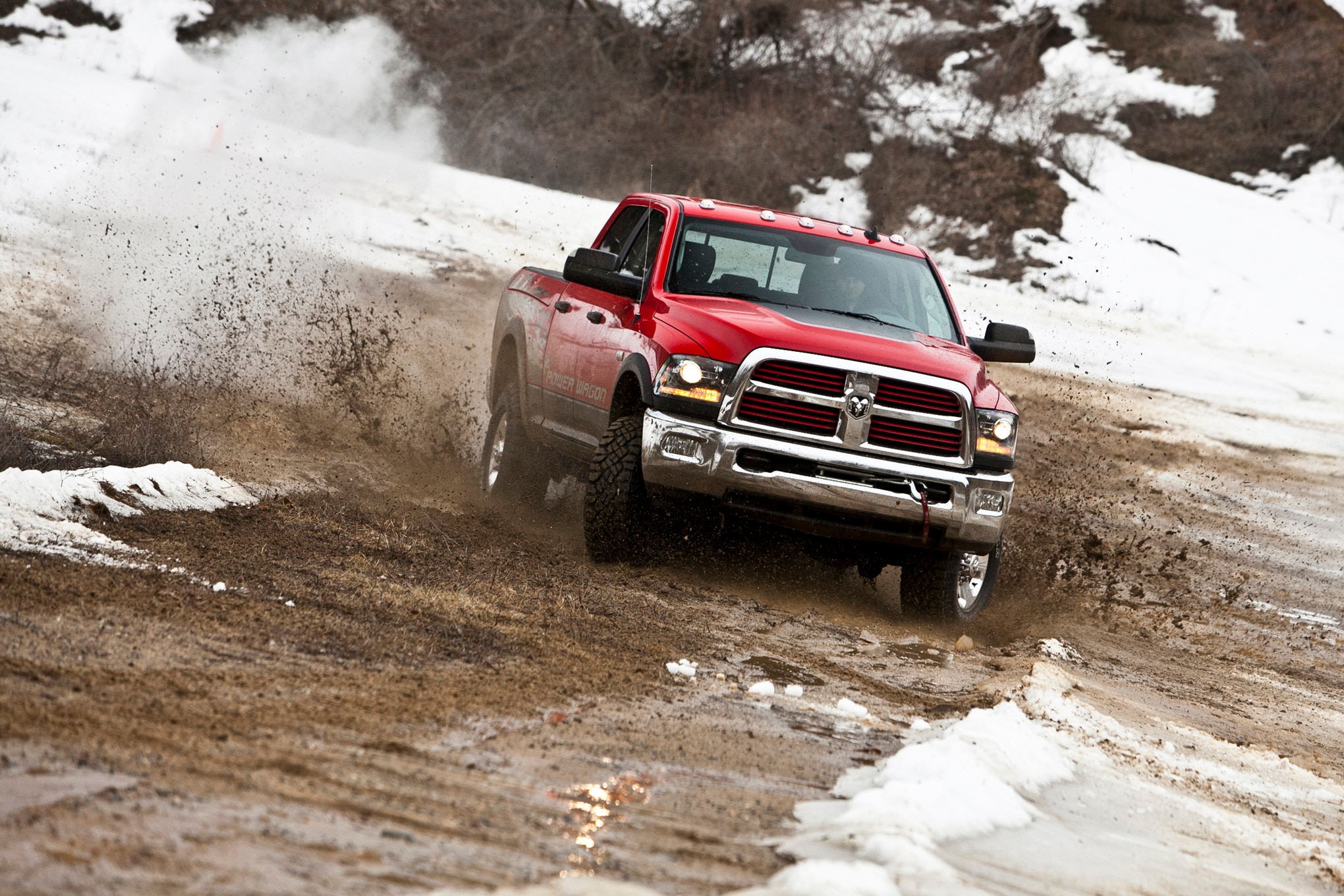 2014 Ram 2500 Power Wagon front three quarter in mud