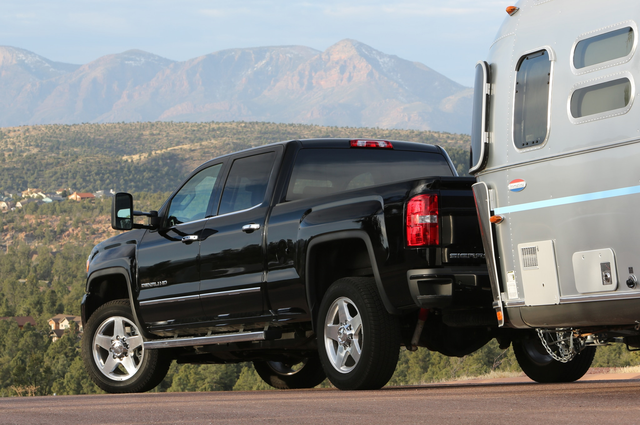 2015 GMC Sierra 2500HD Denali rear view with camper