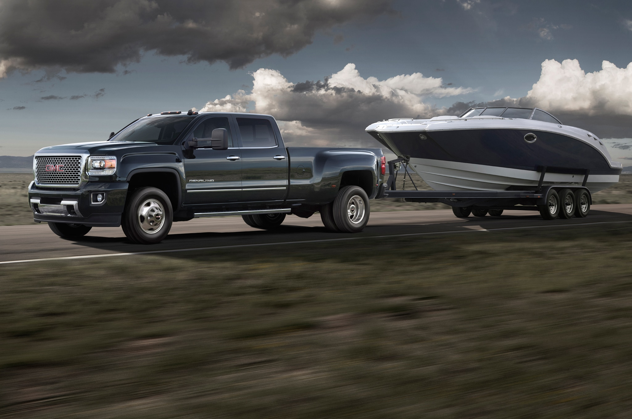 2015 GMC Sierra 3500HD Denali front view in motion
