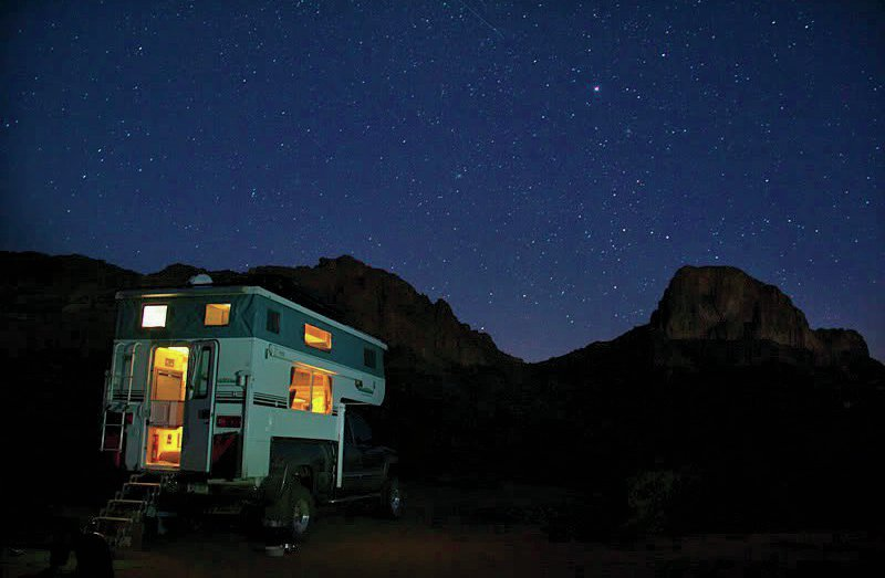 gmc with camper at night