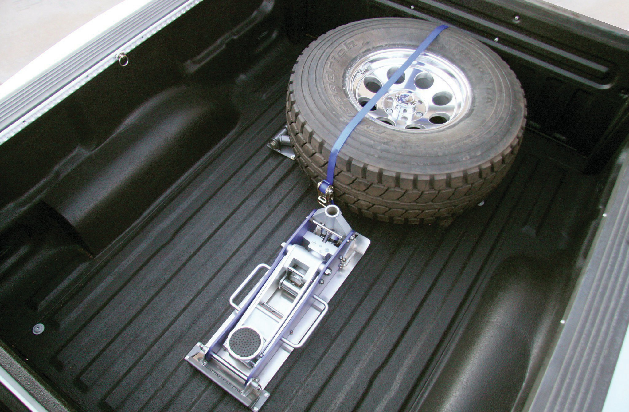 spare tire and jack mounted in bed