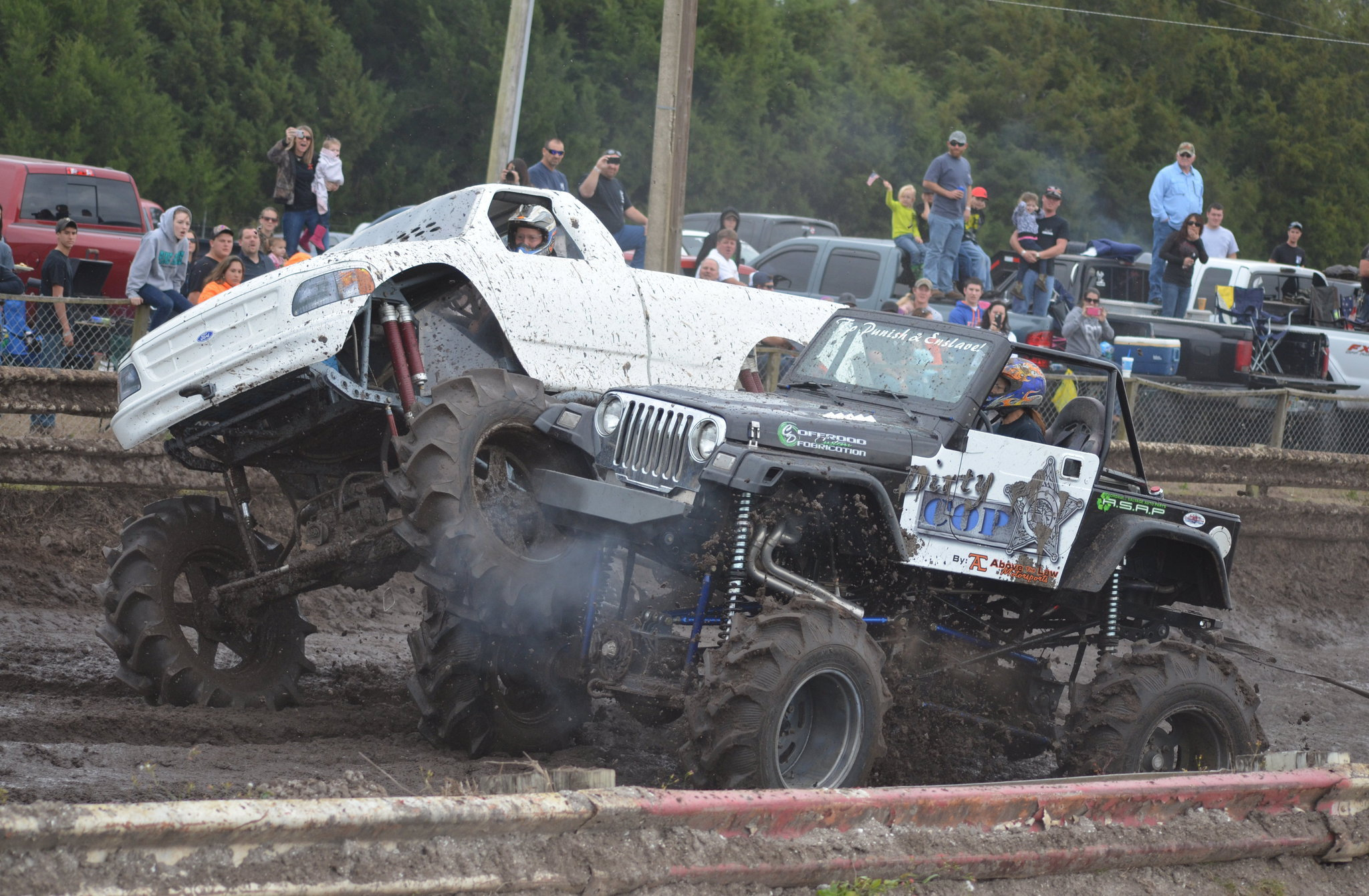 ford and jeep mud trucks racing