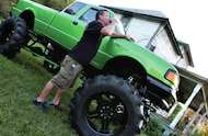 standing next to 1995 ford ranger mud truck