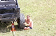 mud girl changing tire
