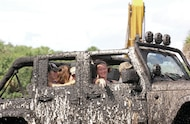 mud girls in muddy jeep