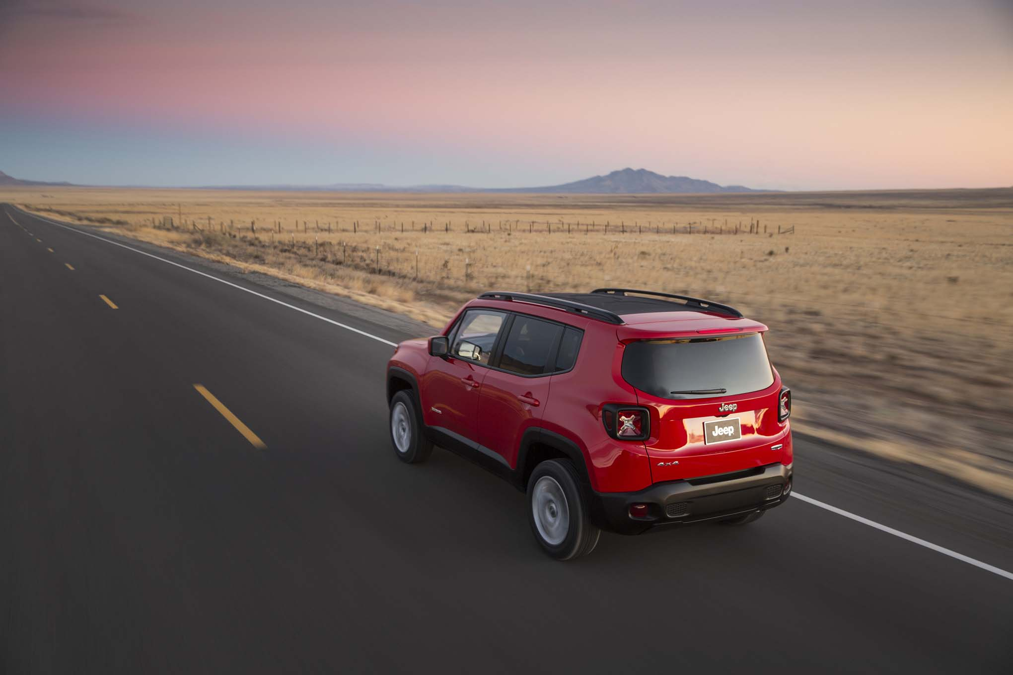 2015 Jeep Renegade Latitude rear three quarters in motion 02
