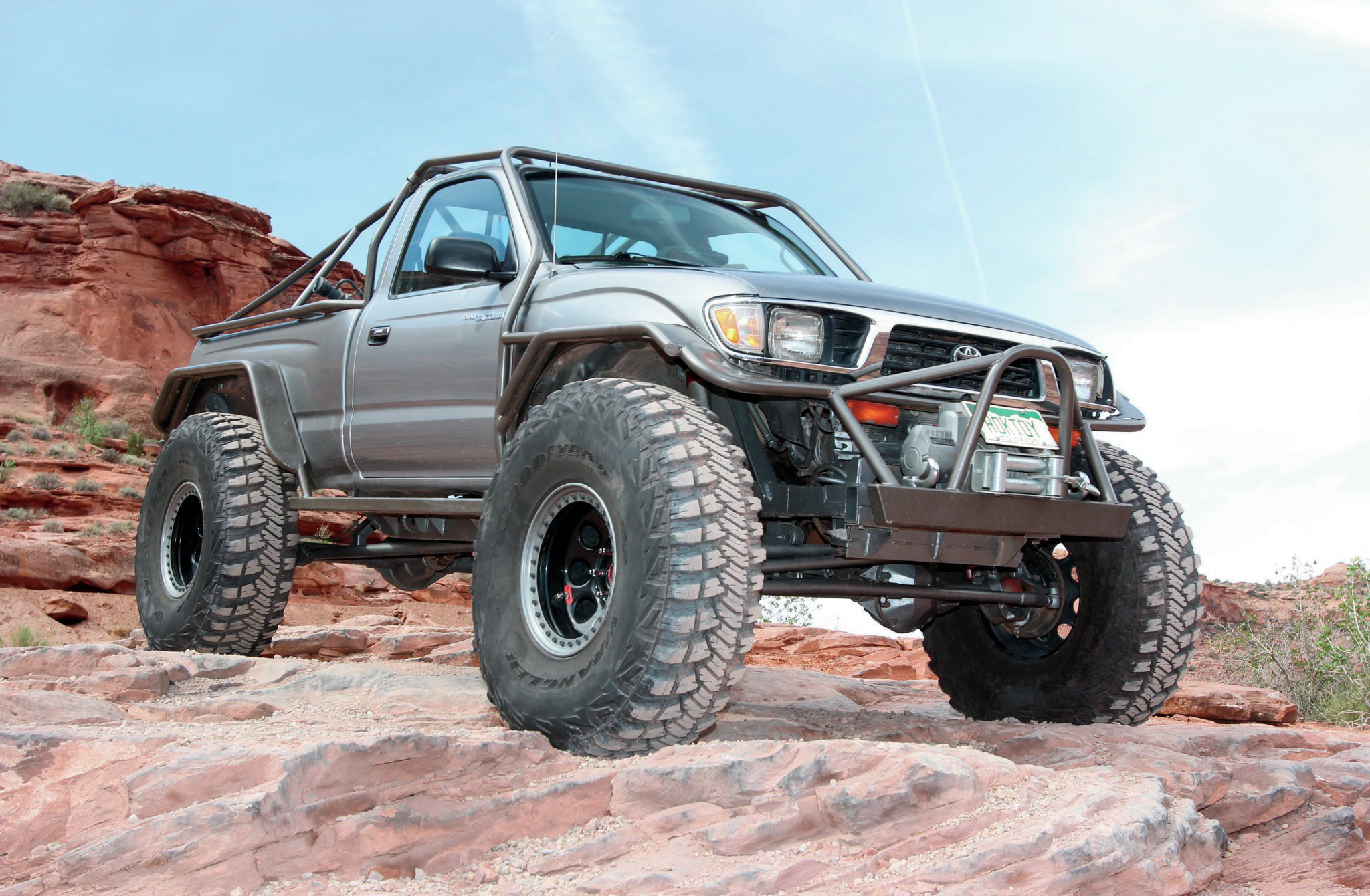 Crist says the original wheelbase of the Tacoma was 103 inches, but it is now 114 inches. This longer wheelbase was accomplished by moving the front axle forward 8 inches and the rear axle aft 3 inches. The frame of the truck was also modified. Six inches of frame was removed above the rear axle and new inboard frame sections were added to allow for shock clearance. Even with about 7 inches of suspension lift, the front fenders and bedsides had to be radiused to allow the large 42-inch tires to move freely.