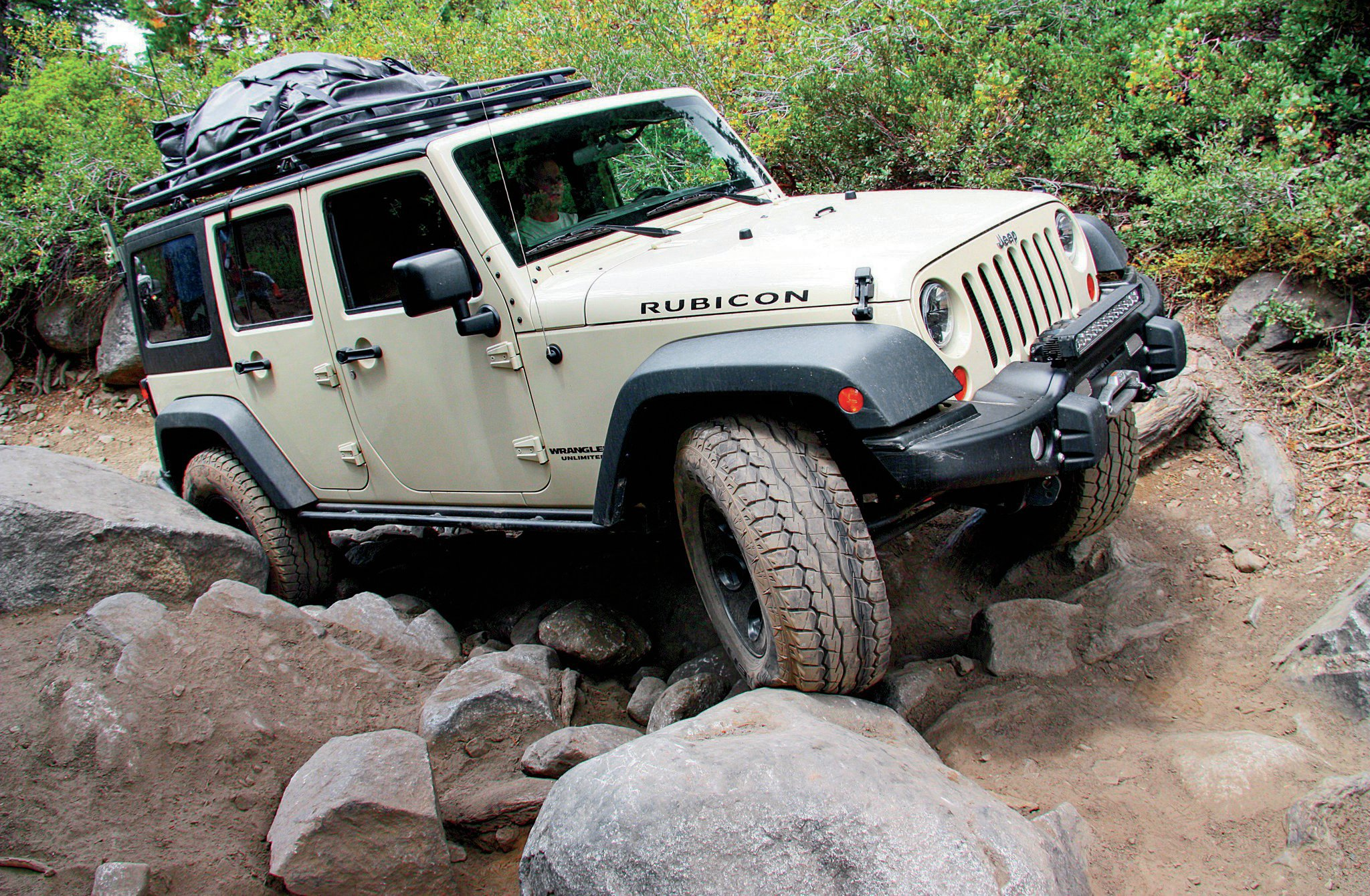 2012 Jeep Wrangler Unlimited Rubicon front three quarter