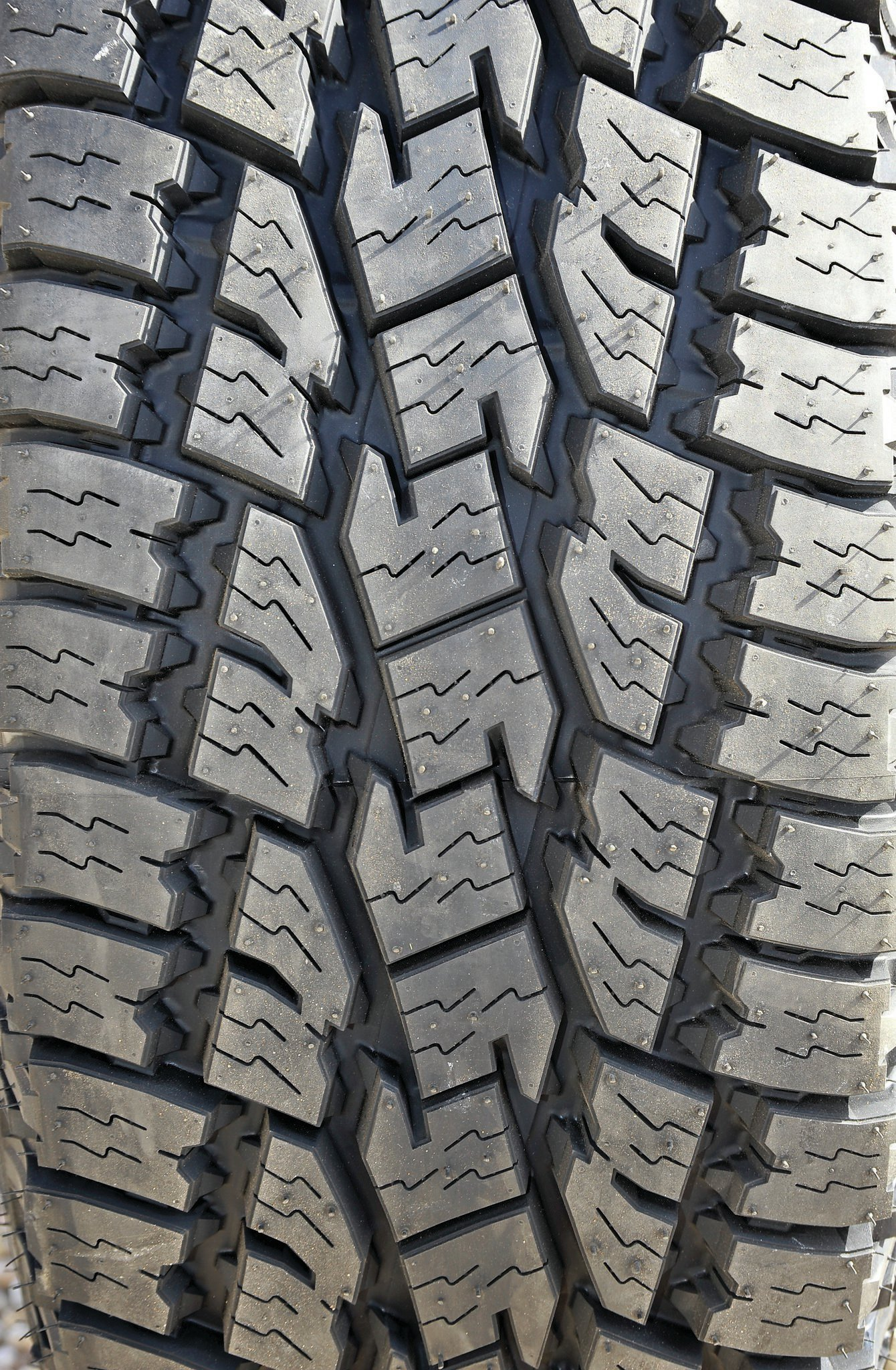 Toyo's Open Country A/T II tread features polygonal blocks and zigzag sipes for excellent traction. The tire is silent and smooth on the road and grips well in the rocks, sand, snow, and dirt. The six-ply tread has two steel, two polyester, and two nylon plies for strength. It's amazing that the Open Country A/T IIs come with a 50,000-mile tread-life warranty.