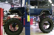 tractor tires mocked up under jeep tj