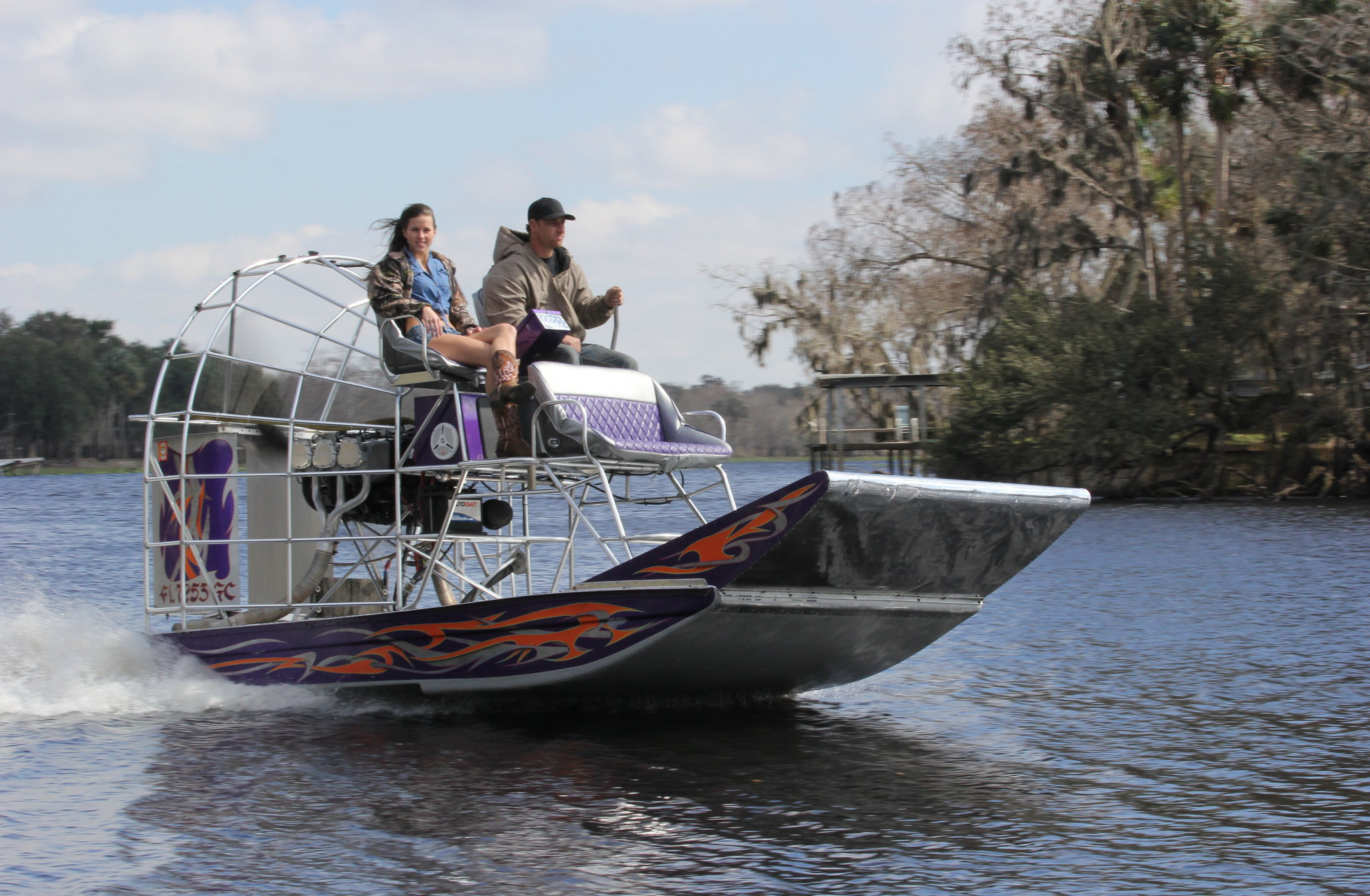 Nikole was excited about the ride. so she jumped on board first and Bret took off down the lake. This airboat hauls ass. It's fun watching it skim across the water.
