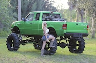 hot mud girl next to 1995 ford ranger mud truck