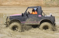 mud girl driving suzuki samurai