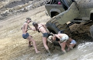 girls wrestling in mud