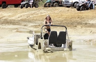 mud girl in stuck jeep
