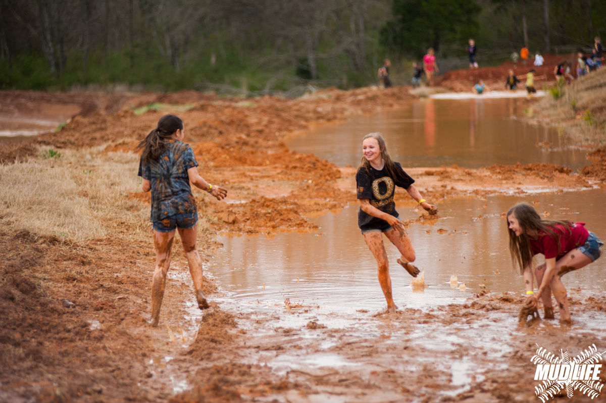 girls playing in mud  3