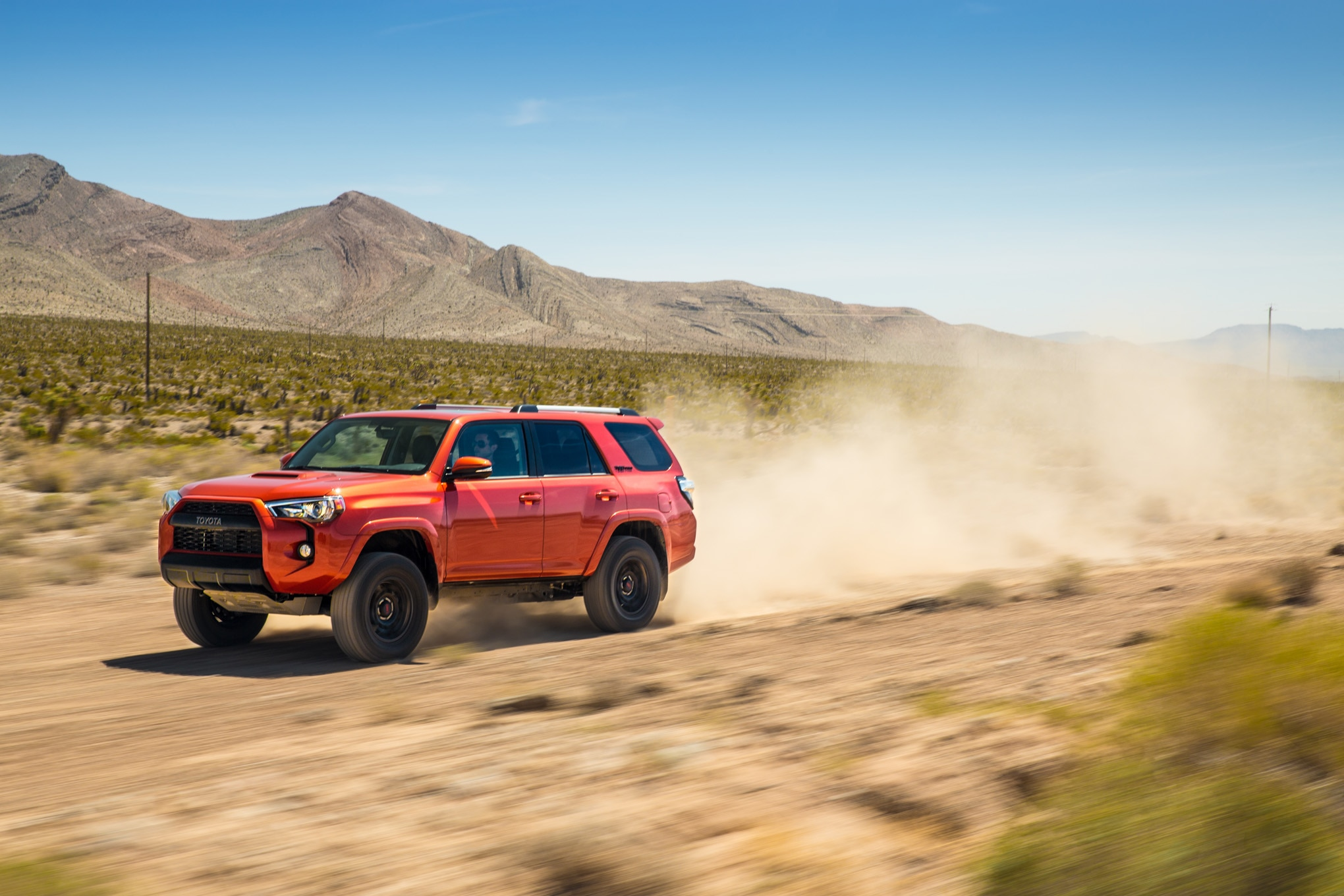 2015 Toyota 4Runner TRD Pro side in motion 07