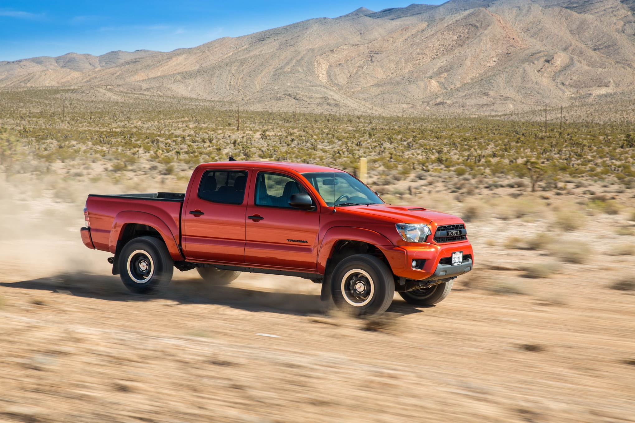 2015 Toyota Tacoma TRD Pro side in motion 03