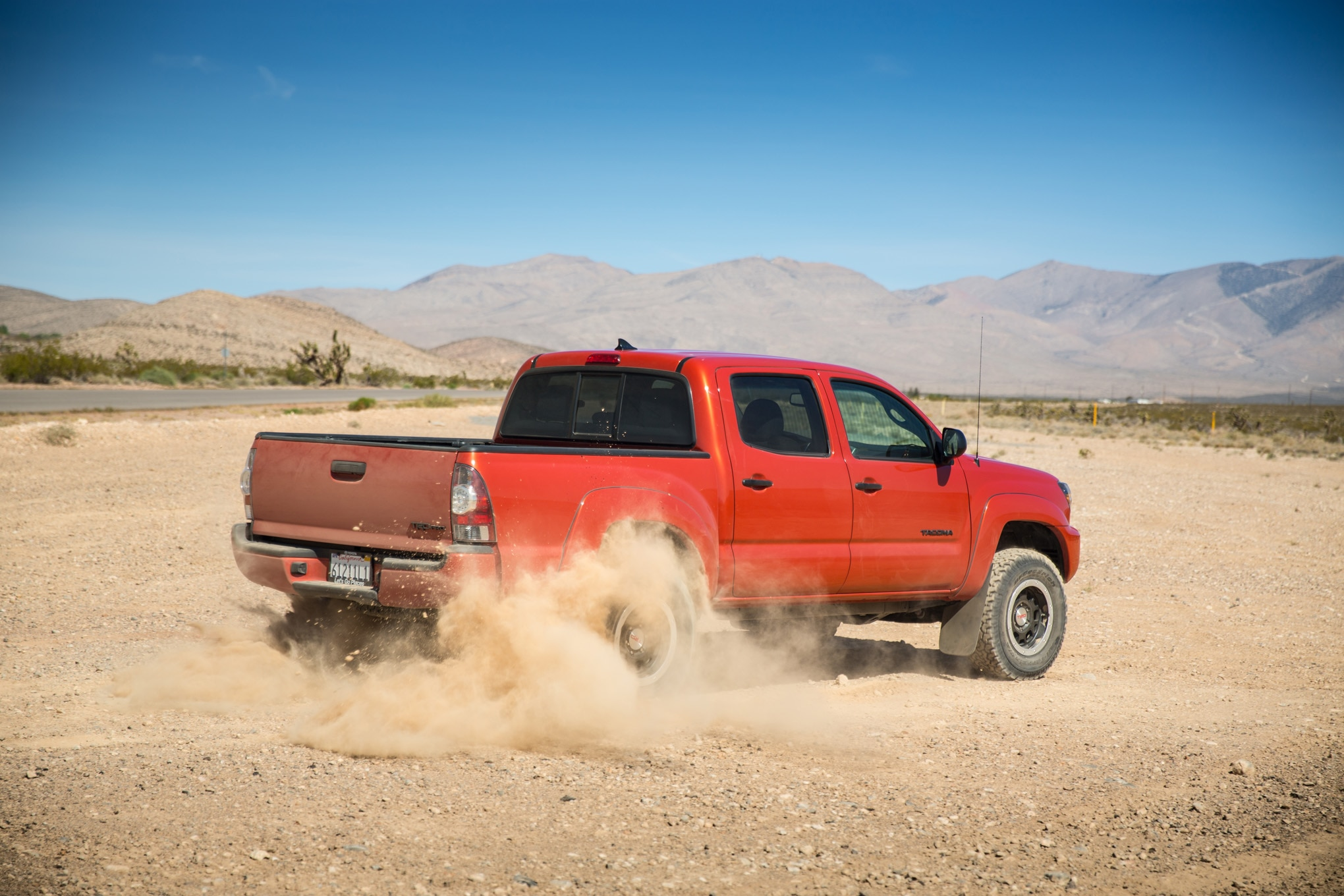 2015 Toyota Tacoma TRD Pro rear three quarter in motion 02