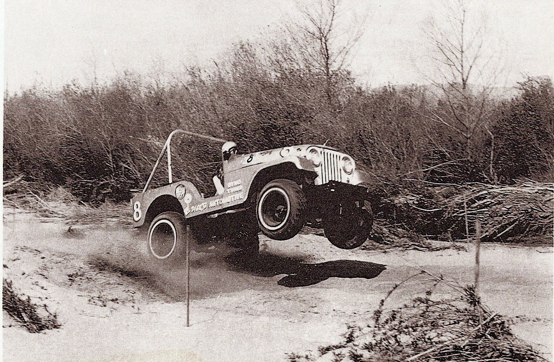 Jeep CJ 5 in motion side three quarter