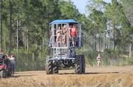 mud girls in custom mud buggy