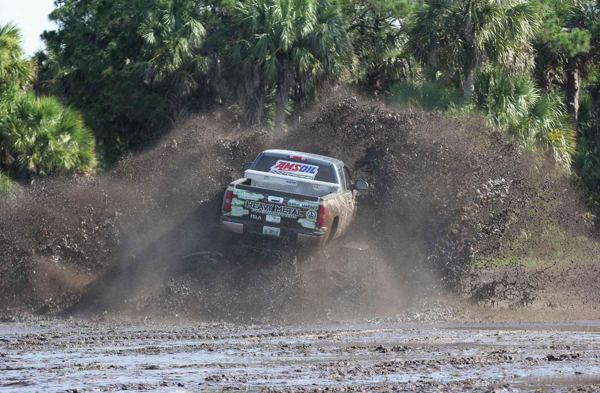 chevy silverado heavy metal mud truck in mud