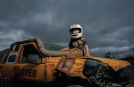 young mud racer on his truck